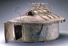 Etruscan, Villanovan Cinerary urn in the form of a house, 8th century B.C. Hammered bronze