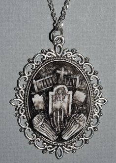 Halloween  Jewelry - Creepy Cute Gothic Necklace  - Victorian Cemetery Necklace with Tombstones Caskets and Skeleton Hand- Zombie  Vampire. $18.00, via Etsy.