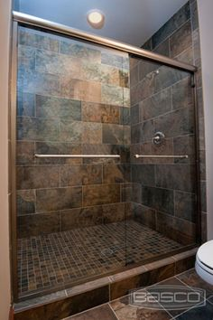 """Basoc Shower Enclosures. Infinity Frameless Sliding Shower Door featuring Burnished Copper Finish and 1/4"""" Clear Glass. View more options and pricing by clicking Infinity 4500 (38""""-48"""") or Infinity 4500 (48"""" - 60"""")."""