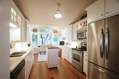 """Lake and Home Magazine Feb/Mar 2014: Wentz Feature Home - """"Large windows in the newly remodeled kitchen open up to views of the beautifully landscaped yard."""""""