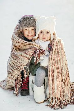 Winter family photos, brother, sister, son, daughter, siblings, hugs, adorable, playful, blanket, snow, hat, scarf, fur, fur boots, trees, sun, Christmas, holiday.