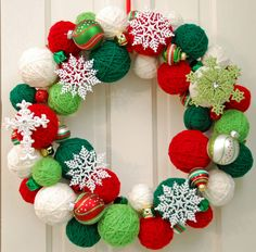 Yarn Ball Wreath (making one right now, I have red and an off-white color, this makes me want to add 2 shades of green and snowflakes, maybe every some ribbon?