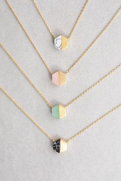 Hexagon stone and metal charm necklace.