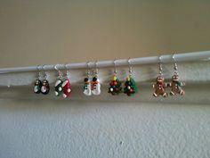 Handmade polymer clay Christmas earrings. Penguins, stockings, snowmen, trees, and gingerbread men.