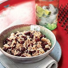 "Classic Jamaican Rice and Peas - (Use brown rice and cup water) Many island dwellers refer to kidney beans as ""peas,"" so don't let the title fool you. This classic Jamaican dish is low in fat yet high in fiber, protein, and calcium. Jamaican Rice And Beans, Jamaican Dishes, Jamaican Cuisine, Jamaican Recipes, Jamaican Coconut Rice, Coconut Rice And Beans, Jamaican Curry, Pea Recipes, Vegetarian Recipes"