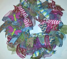 Spring Dragonfly deco mesh Ruffle wreath with High end mesh, ribbon and handpainted decorations!  This wreath has blue, apple green and fuschia/blue/apple green striped deco mesh in a ruffle style along with 6 kinds of colorful ribbons. The wreath is decorated with two handpainted dragonflies a...