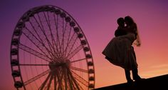wedding photos at the great wheel seattle.  silhouette wedding photos ferris wheel seattle at sunset