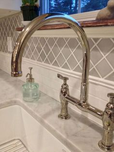 I love this backsplash. Simple but different and beautiful. I might want some color. But as long as it's not plain white subway tile. Countertop: Honed Carrara Backsplash: Horus Art Broadway and California Art Tile