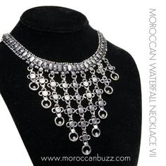 """Elegant, sophisticated and exotic all at once - this show-stopping necklace sets you apart! Handmade in Tiznit, the """"jewelry capitol"""" of Morocco, this piece uses traditional Berber design elements in an updated style. Approximately 16 inches end-to-end; Waterfall: 3.75 inches wide x 2.75 inches long, plus .5 inch main chain = 3.25 inches long. Our handmade jewelry may vary slightly from the photo."""