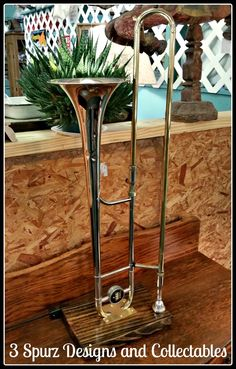 A customer asked if we could make a lamp from her brothers Trombone, so she could give it as a gift to her mother.    Follow us for more wonderful pins at http://pinterest.com/3spurzdandc/ http://facebook.com/ http://www.3spurzdesignsandcollectables.com/home 3 Spurz D&C Repurposed /Refurbished Creations!!