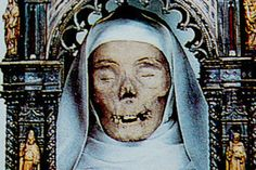 A dismembered holy head stares out from her beautiful reliquary at the St. Dominic Basilica