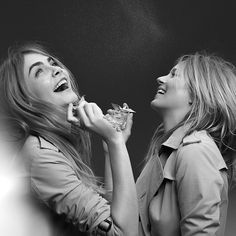 Cara and Kate spritzing the fragrance during the campaign shoot