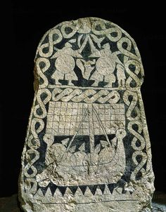 Viking picture stone showing fighting warriors and a longship. Smiss, Gotland…