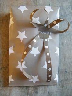 Gift Wrapping with ribbon and sticker