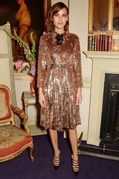 We take a look at the stylish outfits of Alexa Chung, the three time winner of the British Fashion Award's British Style Icon of the Year. British Fashion Awards, Fashion Over, Girl Fashion, Fashion Design, What Is Cocktail Attire, Bronze Dress, Gold Dress, Metallic Dress, Metallic Gold