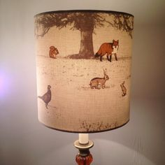Drum Fabric covered Lampshade.This wonderful fabric transforms into the perfect lampshade! The countryside scene contains the creatures most
