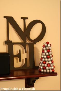 Noel Pottery Barn knockoff - this one uses thinner chipboard letters and is glued/braced with spare pieces of wood