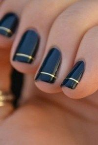 Ive always thought black and gold were the classiest colors. Sharp idea for nails. .
