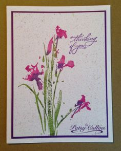 """By Patsy Collins. Stamp image and sentiment. Flicked Ink Technique: Smoosh ink pads onto craft sheet. Spritz. Dip toothbrush into diluted ink. Draw handle of paintbrush or a toothpick across bristles of toothbrush to create splatters. Flower stamp is """"Irises"""" by Penny Black."""
