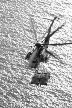 Helicopter with humvies.
