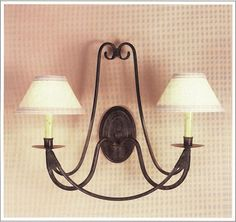 """9068  IRON WALL LAMP FINISH SHOWN: PUEBLO SHADE: 3X7X4 SHOWN WITH ANTIQUE PAPER CANDLE MAXIMUM WATTAGE: 120 TWO CANDELABRA BASE SOCKETS HT 18"""" W 22"""" PROJ 11"""""""