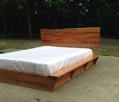 Spalted beech platform bed with live edge slab headboard