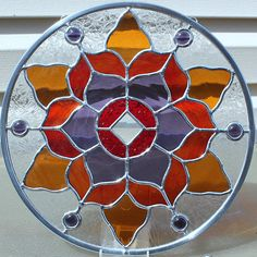 Round Stained Glass Panel in Red Purple and Amber
