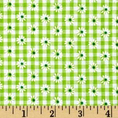 Woven 1/8'' Daisy Gingham Lime from @fabricdotcom  This woven poly/cotton gingham fabric is ultra comfortable to wear and perfect for blouses, dresses, skirts and kids clothing. In warmer climates, it is also appropriate for lightweight pants.  Fabric features printed daisies through out the fabric.