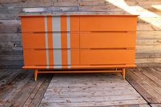 Painted with Annie Sloan chalkpaint in Barcelona Orange and a custom mix of French Linen and Old White for the stripes by Bluebird Upcycled Furniture and Decor