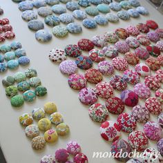 Liberty fabric covered buttons. Great way to display fabrics scraps in your stash.