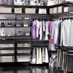 A nicely organized closet. *sigh* =) I have waay more clothes and shoes than this, but I love the closet layout.