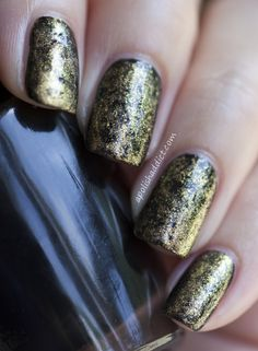 OPI Lady In Black+Chanel Gold Fingers and used the cling film to dab the polish onto the nails