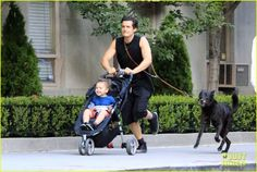 Orlando Bloom takes his son Flynn for a walk in Central Park on July 10, 2013