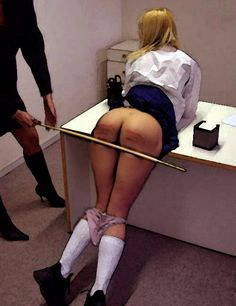 British schoolgirl caned six-of-the-best in the traditional way on her bare-bottom by her headmaster in his study