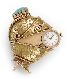 Tiffany & Co./Movado  18K YELLOW GOLD UNUSUAL CONCEALED DIAL PURSE WATCH IN THE FORM OF A HELMET CIRCA 1963
