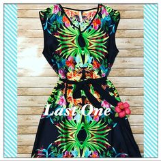 """""""Last One"""" Boutique  Hawaiian Floral Dress🌺 From my Boutique.  This Hawaiian Floral Dress is stylish and nice for the Summer.  Ties around the waist. From shoulder to bottom is 33"""", made of polyester. Boutique Dresses Midi"""