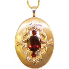 "14K Yellow Gold Signed Vintage Two Picture Locket with Three Pigeon Blood Red Faceted Garnets.  ON SALE NOW at ""Vintage Jewelry Stars"" shop at http://www.rubylane.com/shop/vintagejewelrystars !!"