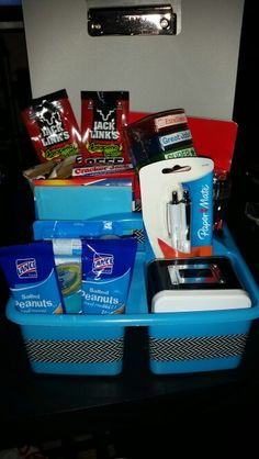 1st day of school male teacher gift: tin of hard candy, ink pens, peanuts, tub of gum, germ-x, aleve, notepad, box of cracker jack, kind nut bars, slim jim, beef jerky, calendar/planner, stamps, tool/flashlight combo, portable phone charger, and clipboard. ..all in a basket decorated with Washi tape 1st Day Of School, School Teacher, Male Teacher Gifts, Teacher Gift Baskets, Beef Jerky, Phone Charger, School Gifts, Hard Candy, Clipboard