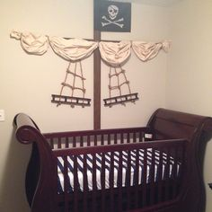 Here are some pics of our baby boy's pirate ship crib we made. More Here are some pics of our baby boy's pirate ship crib we made. Pirate Bedding, Pirate Nursery, Neverland Nursery, Nautical Nursery, Baby Boy Rooms, Baby Boy Nurseries, Baby Room, Baby Crib Diy, Baby Cribs