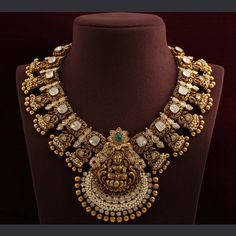 New age temple jewellery necklace royal looking Lakshmi necklace in antique finish 22 carat gold embellished with polki diamonds, small pearls and gold balls. Gold Temple Jewellery, Indian Wedding Jewelry, Indian Jewelry, Gold Jewelry, Gold Bridal Jewellery, South Indian Bridal Jewellery, Gold Necklace, Engraved Necklace, Jewlery