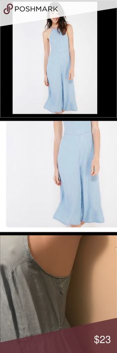 Jumpsuit💋 Trendy jumpsuit with bold gaucho bottoms ,a high square neckline and a self tie open back spaghetti strap ........:jumpsuit  in picture is same style, color, and brand exactly the same as my listing the stock photo just looks better than my photos 🙂 Pants Jumpsuits & Rompers