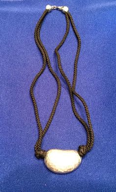 SOLD Alexis Kirk Polished Hammered Bean On A Black Rope Necklace #AlexisKirk #Choker