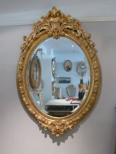A fabulous large Victorian gilt oval mirror with bevelled plate. www.annabellesgiltshop.co.uk