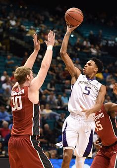 Dejounte Murray of the Washington Huskies shoots against Grant Verhoeven of the Stanford Cardinal during a firstround game of the Pac12 Basketball tournament.