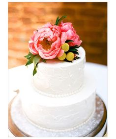 Cut to Dessert  For a stunning cake topper, choose to embellish a plain white cake with a trio of peonies.  Photo by: Austin Gros on Wedding Chicks via Lover.ly