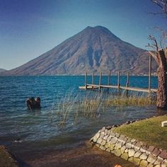 San Pedro Volcano from rhe shores of Lake Atitlan Guatemala. Hiking San Pedro Volcano takes 4 hours. From the summit you are offered a panoramic view of the lake. On a clear day all the way to the Pacific Coast.  #picoftheday #pictures #volcanos #lakeatitlantours #lakeatitlan #lake #hiking #adventurer #seeyouinguatemala #summit #guatemala #guatemalacity #antiguaguatemala #water #watercolor #travel #climbing #views