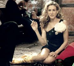 Pin for Later: Carrie Bradshaw's 60 Most Memorable Outfits Season Three The famous oversized flower brooch — so chic.