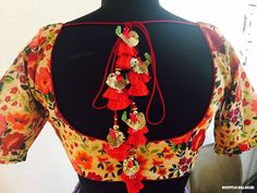 Chittery birds having a beautiful time in their favorite floral garden. Keeping this theme in mind Deepthi Balagiri created this piece of beauty.Beautiful floral blouse with gold bird motif and red tassles from Deepthi Balagiri. 06 July 2017
