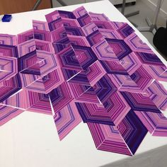 """Absolutely stunning layout of the """"Spinning Stripes"""" blocks using a 60 degree triangle ruler."""