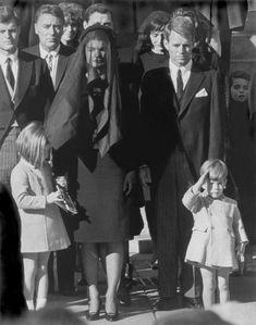 John John Kennedy saluting his father's coffin